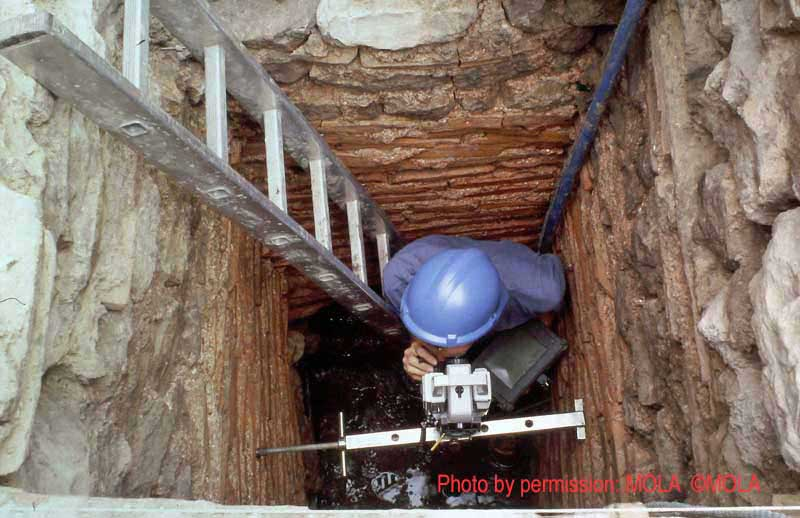 Steve Every surveying in access shaft